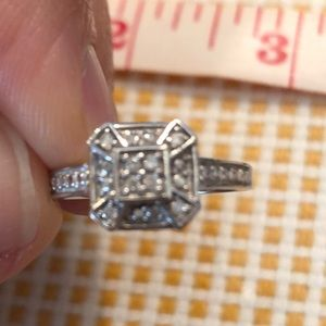 10K White Gold 1/10 Diamond size 6.5 Ring.